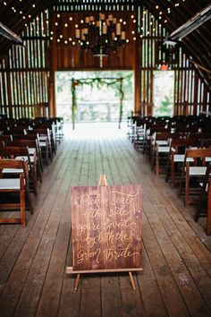 Wooden Barn Ceremony Welcome Sign Fairy Lights Wooden Chairs Floral Arch Creative Quirky Rustic Barn Wedding Tennessee http://www.alexbeephoto.com/