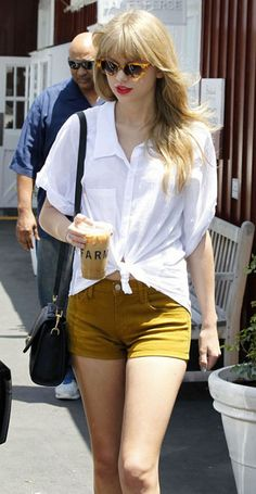dusty mustard shorts, casual look with a matte red lip and 60's California-girl cat eye shades