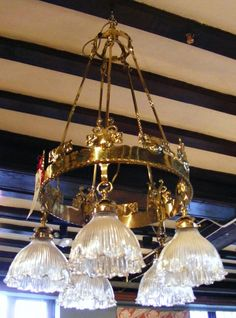 Arts and Crafts hanging light in brass with holophane shades Attributed to Birmingham Guild of Handicraft Circa 1900