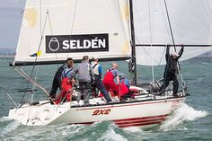 The X-99 yacht '2XS' racing downwind towards the finish line during Cowes Week.