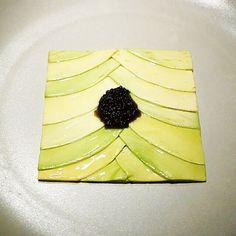 Wafers of avocado and slightly salted caviar