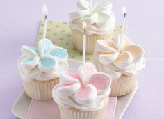 Easy to decorate Flower Cupcakes ~ Using kitchen scissors, cut each marshmallow crosswise into 4 slices. Sprinkle slices with colored sugar. Arrange 5 slices on each cupcakes in flower shape. Place candle or white round cake decor in center of each flower.