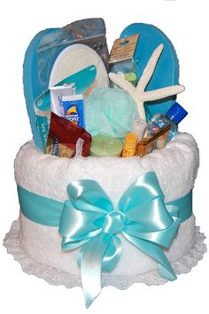 "Spa Pamper Me Basket! All sorts of mani/pedi, sun & spa products stuffed into a towel ""basket"".  Ahhhhhhh"