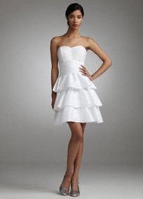 Stunning and chic, this short style is the perfect choice for a reception or any special occasion!  Sweetheart bodice is adorned with sparkling sequin beading for added glamour.  Pleated taffeta detail defines the waistline for a flattering, slimming silhouette.  Tiered A-line skirt is fashionable and feminine.   Invisible side zipper. Length varies by size, refer to size chart for length measurements. Imported polyester and nylon. Dry clean only.  Available in white only.