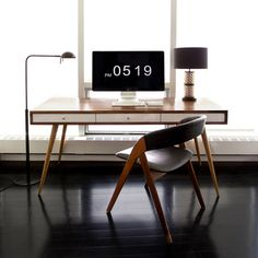 Wish list 2014 - Inspiration no. 1 Main interest - Black wood floors, Mid-Century Desk w/ White Drawers. Simple look.