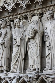 Early Christian Martyr, St Denis, reputedly continued to preach after his beheading.  Facade of Notre Dame, Paris