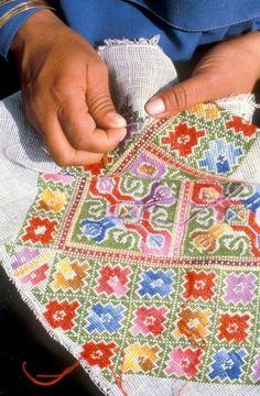 Cross stitch pattern of many colors.