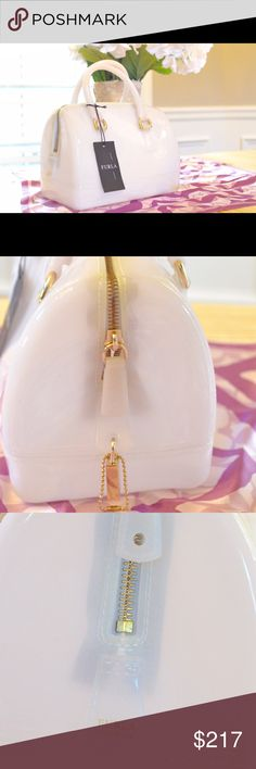 """Furla candy cookie transparent rubber satchel Color is a light cream/white.                              12 ½""""W x 8 ½""""H x 7""""D. (Interior capacity: medium.) 5 ½"""" strap drop.For some fashion-forward fun, take a fresh turn with a color-kissed rubber satchel styled with a ladylike silhouette. Top zip closure. Signature zipper padlock. Protective feet. Rubber or PVC. By Furla; made in Italy. Furla Bags Totes"""