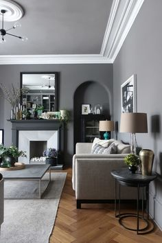 Valspar whistling whippoorwill grey walls. Ikea nockeby sofa, dwell grey marble coffee table on a vintage overdyed rug