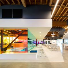 Shared workspaces within the offices of advertising agency Canvas have partitions made of dichroic glass, changing colour when viewed from different angles
