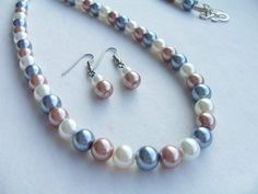 Long glass pearl necklace and earring set  by SparkleandComfort, $16.00
