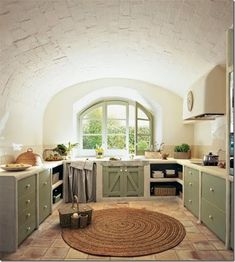 The kitchen is brilliantly simple with cupboard doors made from