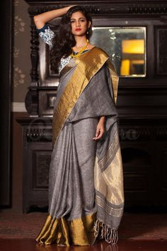 Rich and flowy grey linen saree from Roopkatha is all set to scintillate with magnificent wide zari border. The linen saree is perfect for those who wish to rem Indian Attire, Indian Ethnic Wear, Ethnic Fashion, Indian Fashion, Saree Fashion, Women's Fashion, Fashion Outfits, Fashion Design, Indian Dresses