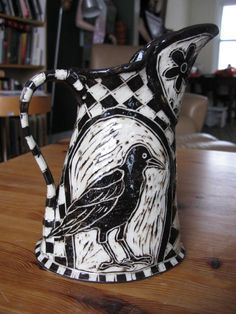 A smaller pitcher with a crow on it. Description from knitnut.net. I searched for this on bing.com/images