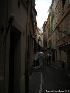 3 story building make for a mood meandering alley way that snakes away in the distance