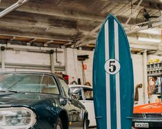 "We've decided to create a replica of the 78 MR Freeride with a more ""racey"" twist. This is the final product sitting next to a beautiful Jaguar of the same racing green colour. Custom Surfboards, New Crafts, Surf Shop, Jaguar, Green Colors, Custom Design, Surfing, Racing, Colour"