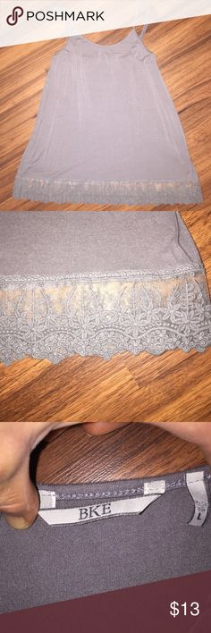 BKE Grey Flowy Lace Bottom Tank BKE Grey Flowy Lace Bottom Tank. Size Large. Adjustable straps. Very beautiful on and looks stunning alone or can be worn under Tanks, Shirts, And Sweaters for a layered look. In great condition. Buckle Tops Tank Tops