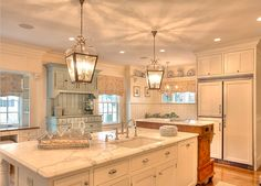 white marble kitchen with beadboard, antique sideboard / cabinet and pale blue hutch.  taupe and blue toile fabric