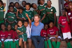 Pin for Later: The Best Pictures of the British Royals in 2015 When Harry Bonded With an Adorable Group of Kids in South Africa