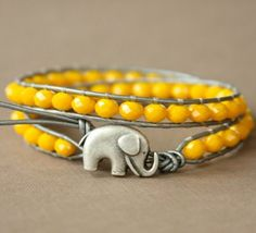 Elephant for luck. Yellow for happiness.  All you need, minus love