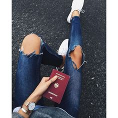ripped denim jeans, booklet and white sneakers