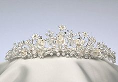 Tiara Hair Jewelry Pearl Fantasia Headpiece. A creation of delight from the Illusions Bridal Tiara collection of elegant tiaras, headpieces and hair jewelry. Elegant creation of tiny faux pearls and frosted flowers are the feature of this tiara. Perhaps perfect for the bride to wear on her wedding day or for your prom, pageant, quinceanera or next formal occasion