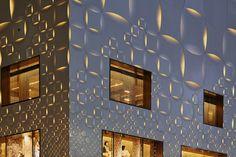 jun aoki's tokyo louis vuitton store features patterned façades