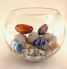 This is a cute idea... paint some rocks to look like fish and put them in a bowl! The bottom rocks could be painted blue to look like water :)