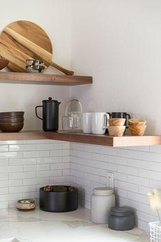 open shelving, subway tile backsplash ideas // walnut open shelving in kitchen