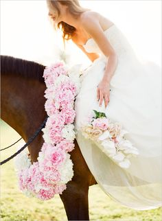 KT Merry-- would love to have horses at a beach wedding!