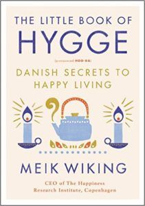 """""""Meik Wiking… knows the secret to happiness… [he] has written a gorgeously designed… guide to the Danish state of being that embraces coziness, sociability, thankfulness and comfort food.""""      ~ The Times  of London"""