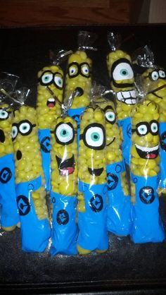Despicable Me Minion Candy Party Favors. Hand painted clear pretzel bags and filled with yellow candy. Made by Sandra Schneiderman