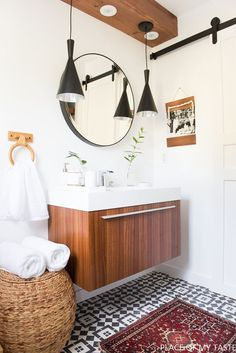 This is a jaw dropping bathroom makeover. You need to see the before and after! Modern, chic bathroom makeover with lots of cool design. The geometric ceramic floor tiles are way stylish
