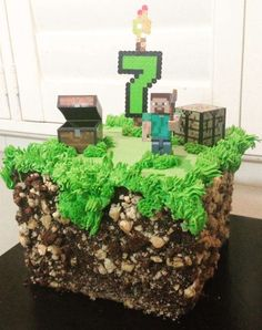 What a fantastic grass block cake at a Minecraft birthday party! See more party planning ideas at CatchMyParty.com!