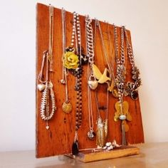 This jewellery stand made from a reclaimed floorboard is a good DIY craft for your room