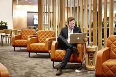 Passenger works on laptop at Qantas First Class Lounge at Sydney Airport. Photo Credit: Qantas.