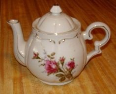 "I have a teapot similar to this one. It was my Grandma's and plays 'Tea for Two"". I am sure it dates back at least to  the 1960's since she passed away in 1968. It makes me smile when ever I hear it play. : )"