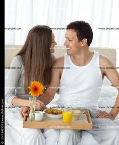 http://www.photaki.com/picture-passionate-couple-with-their-breakfast-sitting-on-the-bed_948935.htm