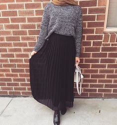 A long skirt looks elegant at any occasion it is worn to. It is an essential piece of clothing for […] Long Skirt Hijab, Long Skirt Outfits, Winter Skirt Outfit, Winter Outfits, Long Skirts, Dress Winter, Pleated Skirt, Waist Skirt, Dress Long