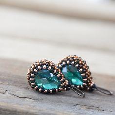 Emerald green earrings with green teardrop glass bead in copper brown beadwoven bezel