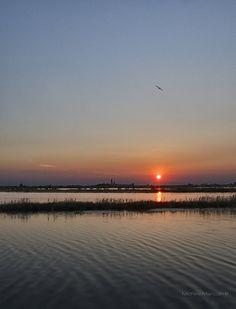Sunset at Barbana's sanctuary n its lagoon in Grado, Gorizia_ Italy