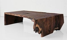 FOLD RAW EDGE WALNUT SLAB COFFEE TABLE  Materials: Solid walnut Dimensions: 58L x 34W x 16W  Options: Wood species, size, style
