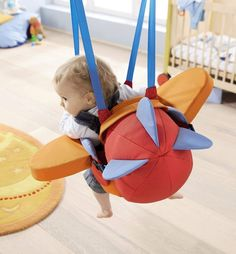 """Aircraft Swing This cute indoor aircraft swing takes your baby on a fun plane ride through the sky of the room while its rattling propeller adds an extra """"vrrroom!!"""" 71cX46vaRRL._SL1063_ Awesome toys for babies and toddlers #Toysforkids #toys"""