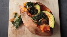 Top your baked sweet potato with a Swiss chard and onion mix with avocado slices.
