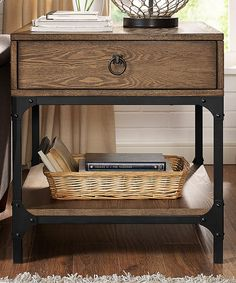 Made from solid hardwood and featuring a drawer and shelf, this understated yet elegant side table is the ideal way to add extra storage to the living room without sacrificing style.