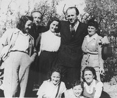 October 1944: Oskar Schindler, a German officer, saves 1200 Jews by moving them from Plaszow labor camp to his factory in Sudetenland. Photograph shows Schindler (second from right) with a few of the Jewish workers he saved.   Source: United States Holocaust Memorial Museum