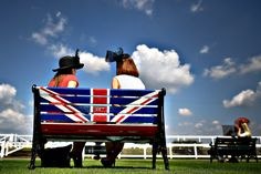 Race-goers relax on a bench displaying the Union Flag on day one of the Royal Ascot horse racing festival, in Ascot, England. Festivals In England, Windsor Palace, White Cliffs Of Dover, South East England, Blenheim Palace, Union Flags, Royal Ascot, Union Jack