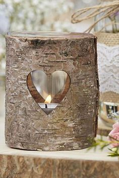 Rustic wedding logs table decorations. These country rustic wedding candle holders are made for tea lights. Scroll to Elegant Country Rustic Wedding Ideas number 16 for more info and to buy. #weddingcandles #RusticWedding #CountryWedding #WeddingIdeas