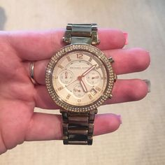 Michael Kors watch Used Michael Kors watch. One rhinestone missing and small scratch on glass face. Needs new battery. The gold color is a little worn on the band on one side where arm rests. Links have been taken out but still have them. Michael Kors Accessories Watches