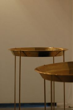 Brass Tables with perforated designs on the surface by Ira Studio. www.irastudio.net